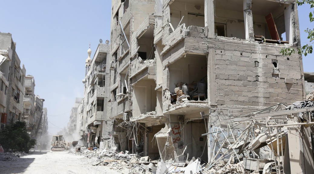 epa04355118 A general view of a street of destroyed buildings 15 August 2014 in the town of  al-Mleiha, ten kilometres south east of Damascus during a government organised tour for journalists. Syrian troops recaptured the town a day earlier from armed groups after five months of heavy fighting.   According to a statement issued by the General Command of the Army and Armed Forces, army troops restored security and stability to al-Mleiha and the surrounding farms in the Eastern Ghouta area, adding that this was achieved following a series of decisive special operations in which the army eliminated large numbers of terrorists who were holed up in the town.  EPA/YOUSSEF BADAWI